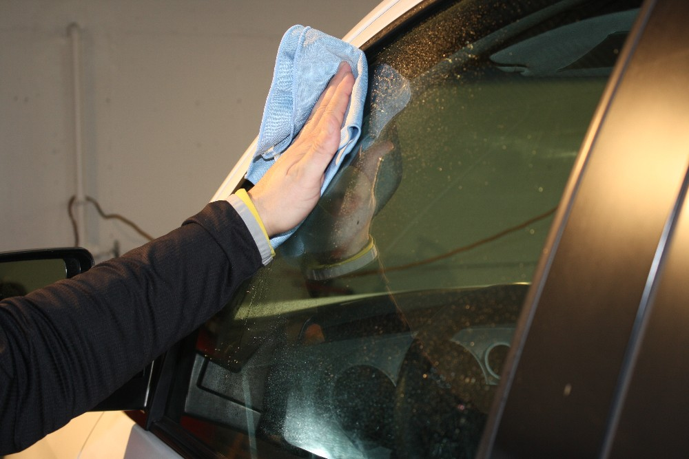 Wipe Away Windows Spots with Glass Cleaner and Window Towel